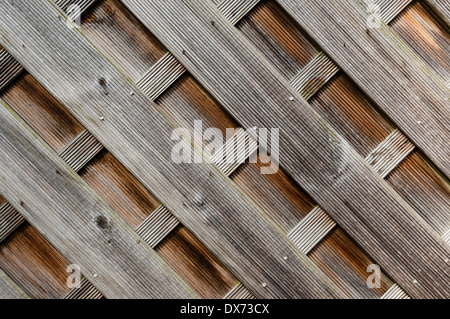 Wooden fence paneling, diagonal shapes, landscape, even light - Stock Photo