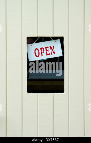 OPEN sign in a shop door window. Stow on the Wold, Cotswolds, Gloucestershire, England - Stock Photo