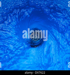 Plug Hole Water with Vortex Effect - Stock Photo