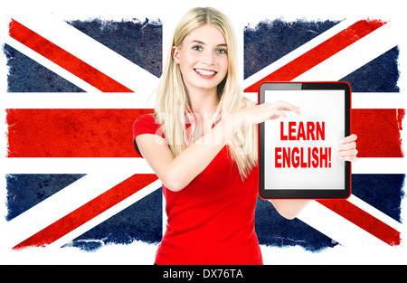 young woman holding tablet pc on the background with british national flag. english learning concept - Stock Photo
