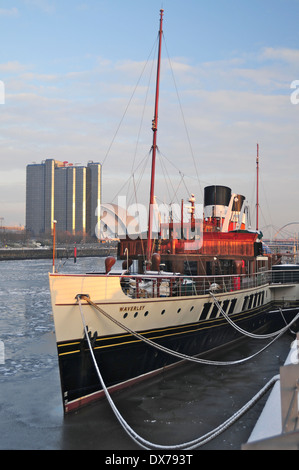 Waverly Paddle Steamer, berthed in Glasgow. River Clyde partially frozen during bad winter of 2010 - Stock Photo