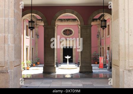 Pink inner courtyard in the Palacio Nacional, Zócalo, Mexico City - Stock Photo