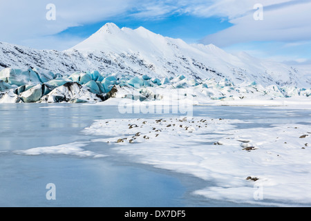 The aqua blue tongue of Heinabergs glacier and frozen glacial lagoon in Southeast Iceland near Hofn - Stock Photo
