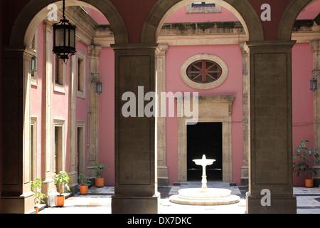Pink inner courtyard with fountain in Palacio Nacional, Zócalo, Mexico City - Stock Photo