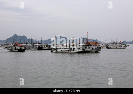 Tour boats moored in Ha Long Bay. Vietnam South East Asia - Stock Photo