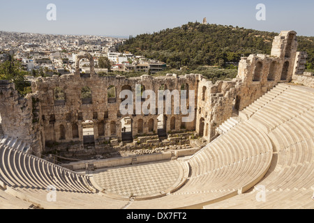 Odeon of Herodes Atticus at the Acropolis and Filopappos Monument on Filopappos Hill in background, Athens, Greece - Stock Photo