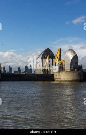 Shown here in the raised position, the Thames Barrier is located downstream of central London, United Kingdom, operational - Stock Photo