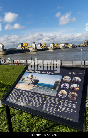 Looking inside the barrier: a sign that explains the workings of the Thames Flood Barrier, shown here in the raised - Stock Photo