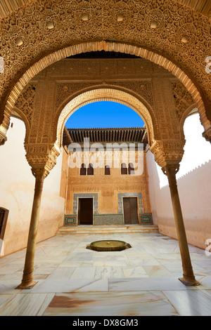 Nasrid mocarabe Arab pillars and capitals in the inner courtyard of the Palacios Nazaries, Alhambra. Granada,