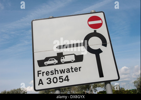 Road sign on the Isle of Wight showing the way to the Freshwater car ferry. - Stock Photo