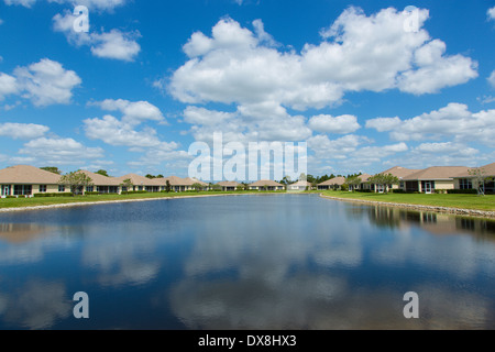 Houses around small lake in housing development in North Port Florida - Stock Photo