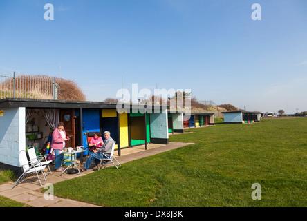 People enjoying their Block built beach hut. - Stock Photo