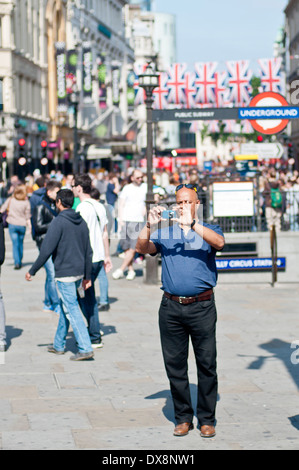 Middle Aged Man Is taking Pictures, Piccadilly Circus - Stock Photo