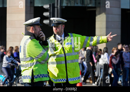 Two uniform Metropolitan Traffic Police officers talking about a situation, London, England, United Kingdom. - Stock Photo