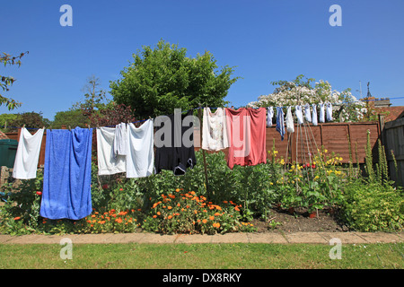 Clean Clothes drying on a Washing Line - Stock Photo