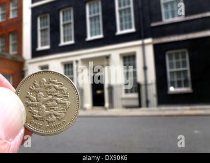 London, UK. 19th March 2014.  A pound coin on the street outside Number 11 Downing Street on Budget Day. A new one - Stock Photo