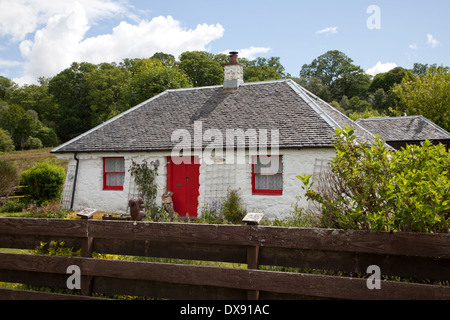 Whitewashed Crofters Cottage on the shore of  Loch Eil at Blaich near Fort William in the Western Highlands  of - Stock Photo