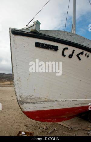 Canada, Nunavut, Qikiqtaaluk Region, Cape Dorset. Wooden fishing boat on Cape Dorset beach. - Stock Photo