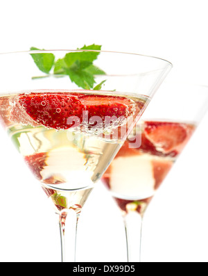 strawberry cocktail with berry in martini glass isolated on white background. festive arrangement with sparkling - Stock Photo