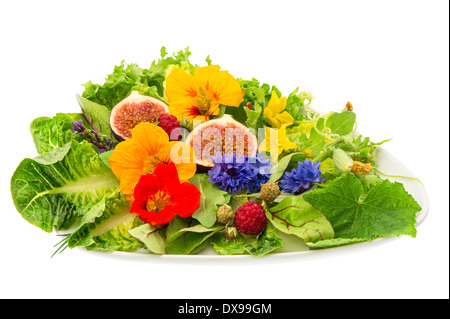 fresh green salad with flowers and fig fruits isolated on white background. healthy food - Stock Photo