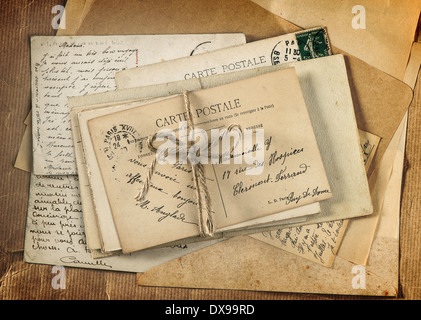 old letters and antique french postcards. vintage sentimental background retro style - Stock Photo