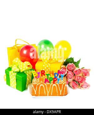 colorful birthday decoration with cake, candles, gifts, air balloons and rose flowers. card concept - Stock Photo