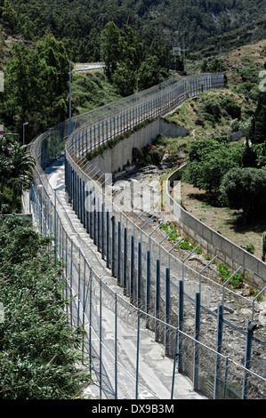 Perimeter fence in Benzu village that separates the Spanish enclave of Ceuta and Morocco. - Stock Photo