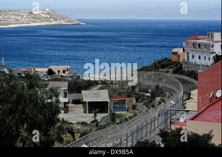 Perimeter fence in Benzu village that separates the Spanish enclave of Ceuta and Morocco, the strait of Gibraltar - Stock Photo