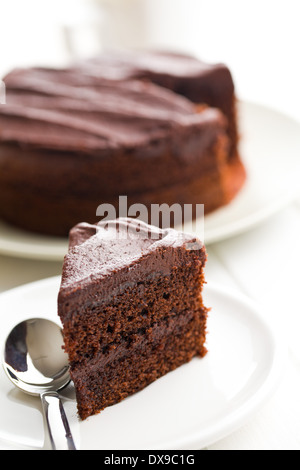 dark chocolate cake on plate - Stock Photo