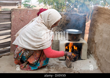 Rural Indian Village Woman Using Quern Stones To Grind
