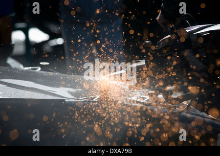 disk cutter cutting wheel angle grinder grinding cut steel metal sparks spark flying spray spraying of stihl saw - Stock Photo