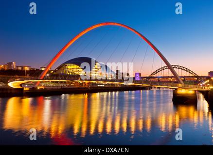 Newcastle upon Tyne skyline at night gateshead Millennium bridge over River Tyne Tyne and Wear Tyneside England - Stock Photo