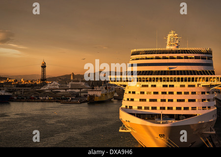 Sunset cruise ship docked in harbor, Barcelona, Spain - Stock Photo