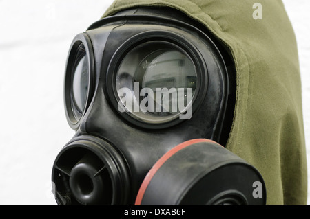 Gasmask and Nuclear, Biological and Chemical (NBC) suit - Stock Photo