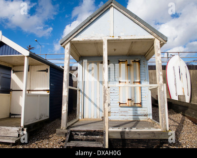 Wooden beach hut on the seafront - Stock Photo