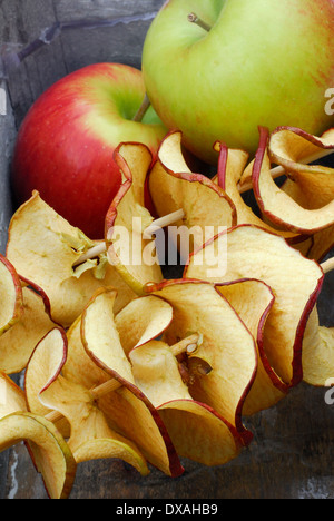 Apple and dried apple rings - Stock Photo