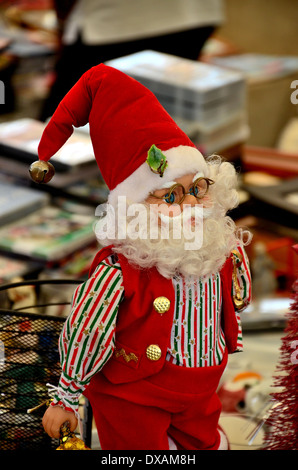 Santa Claus doll with glasses and bell found in Sunday Bazaar Karachi Pakistan - Stock Photo