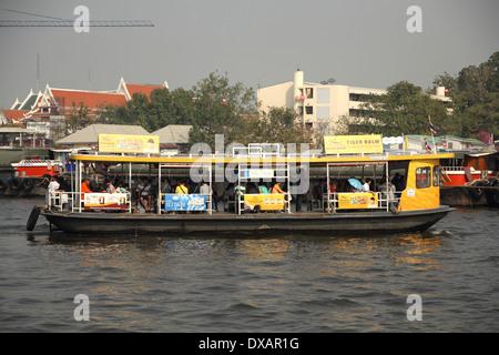 A ferry boat crossing Chao Phraya River in Bangkok , Thailand - Stock Photo