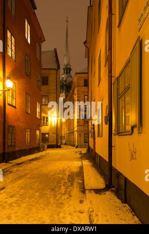 Winter night view of the German Church ('Tyska kyrkan') seen from German School Alley ('Tyska Skolgränd'), Gamla - Stock Photo