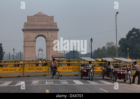 Bicycle Rickshaw in front of India Gate and the Canopy in Delhi, India - Stock Photo
