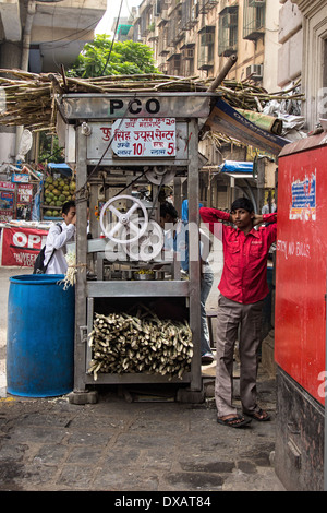 Street stall selling sugarcane Juice in Mumbai, India - Stock Photo