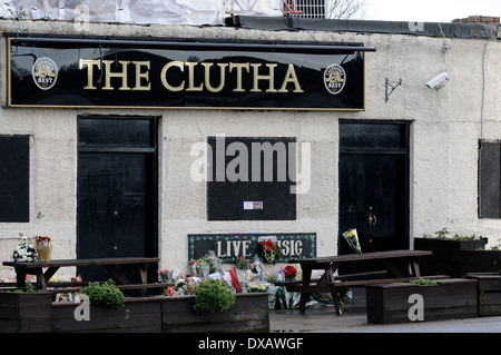 Several floral tributes have been place at the Clutha bar in Glasgow. A 10th victim of the accident has been announced. - Stock Photo