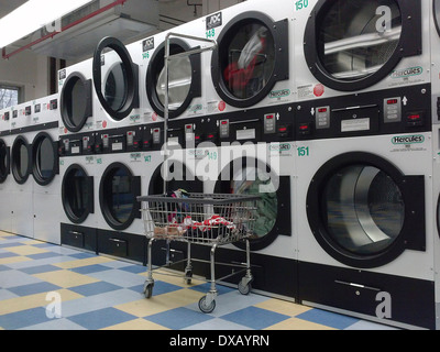 An empty laundry room in an apartment building in New York on March 16, 2014. (© Richard B. Levine) - Stock Photo