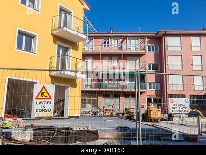 Italian new house apartment building with sign saying works in progress, Liguria, Italy - Stock Photo