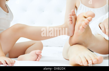 Family's feet in the bed - Stock Photo