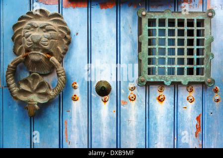 Old historic door knocker on a blue door in Cartagena, Colombia - Stock Photo