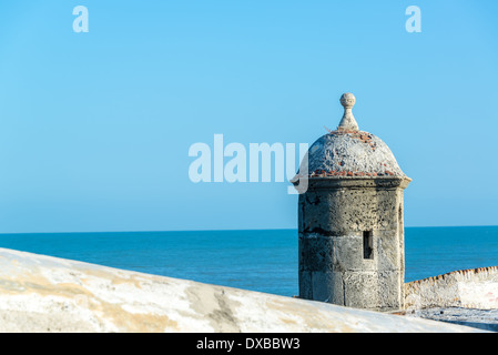 View of the defensive wall surrounding the old city of Cartagena, Colombia with the Caribbean Sea visible in the - Stock Photo