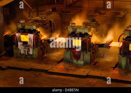 Rolling hot steel to wire rod in four strand mill. - Stock Photo