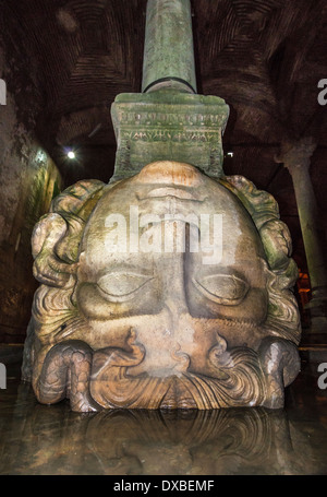 Ancient carved head of Medusa used to support column in the Yerebatan underground Cistern, Sultanahmet, Istanbul, - Stock Photo