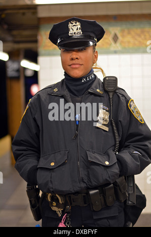 Portrait of New York City police officer Rodriguez on a subway platform in Midtown Manhattan, New York City. - Stock Photo